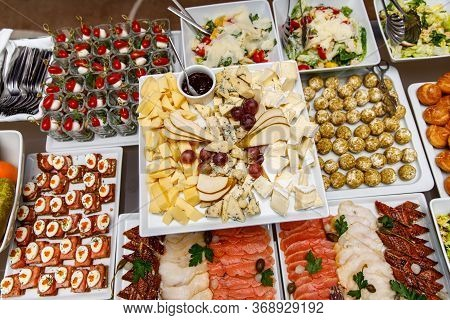Cheese Plate With Other Snacks On A Banquet Table.