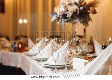 Wedding Table Setting With Empty Wine Glasses