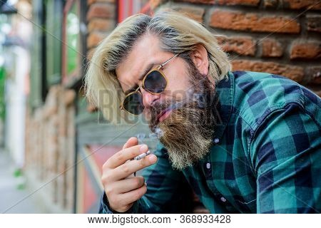 Cigarette Smoke. Close Up Portrait Of Smoking Man. Sensual Bearded Hipster With Cigarette. Bearded M