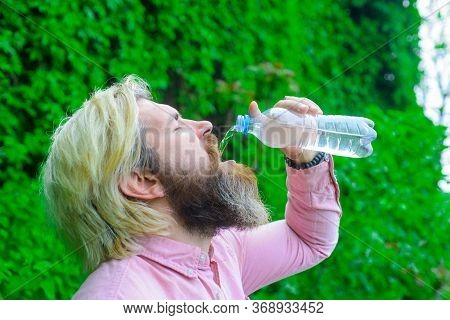 Man Drink Water Outdoor. Man With Water Bottle. Healthy Lifestyle. Health Care Concept. Drinking Wat