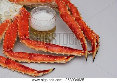 Legs Of Boiled Crab-appetizer For Beer. Beer In A Glass.