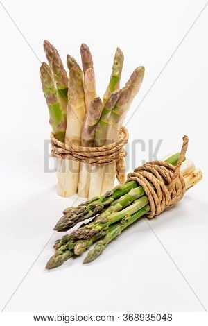 Green And White Fresh Asparagus On A Gray Background