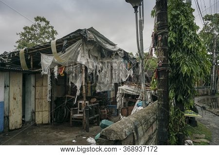 Howrah, West Bengal, India - 21st May 2020 : Super Cyclone Amphan Devastated Shops And Damaged Sever