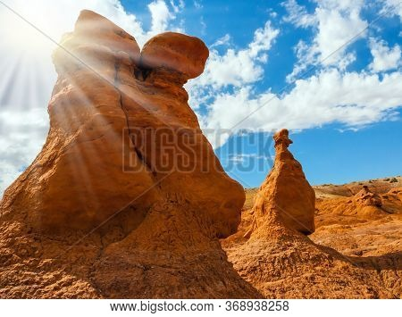 Funny red-brown sandstone remnants formed by erosion. Scenic Utah state park Goblin Valley. USA. Hoodoo - geological formations. The concept of active, ecological and photo tourism