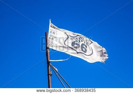 Flag of historic transnational road 66. Historic motorway 66. Great car trip across America. Great US highway. The concept of automotive, active and photo tourism