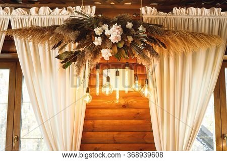 Wedding Decor In Hall With Floral Arrangement