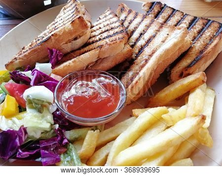 Tuna Sandwich This Is A Mediterranean Tuna Sandwich. Grilled And Garnished With Fresh Salad And Fren
