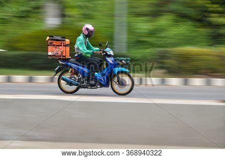 Samut Sakhon Province, Thailand - May 2020: Motorcycle Riders Deliver Products Quickly To Customers