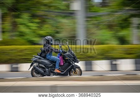 Samut Sakhon, Thailand - May 2020: Motion Image Of Panning Photos Of Unidentified Women People Ridin