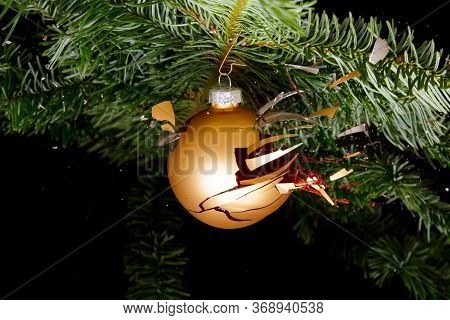 Bauble On A Christmas Tree Exploding. Concept For Troubled Holidays