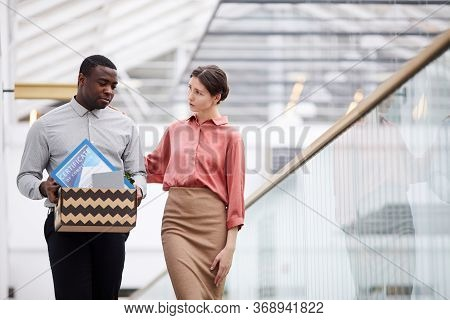 Waist Up Portrait Of Young Female Manager Supporting African-american Man Leaving Job, Copy Space