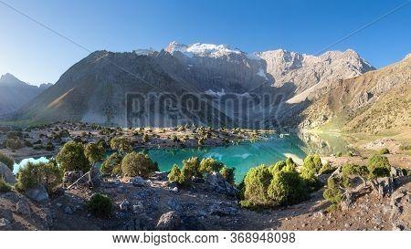 Beautiful Panorama Of Fann Mountains. Alaudin Lake In Fann Mountains, Tajikistan. Summer Day For Hik