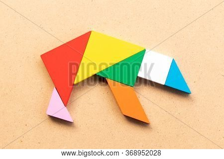 Color Tangram Puzzle In Grizzly Or Polar Bear Shape On Wood Bacground