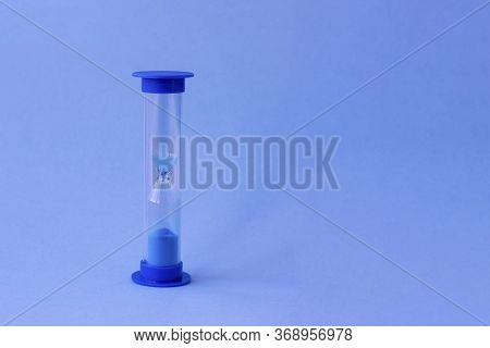 Hourglass With Falling Sand Inside Of Them As A Symbol Of Running Time, Lifetime And Leak Of Time. S