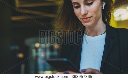 Confident Young Woman In Black Suit Working Documents Using Smartphone Near Modern Office, Female Pe