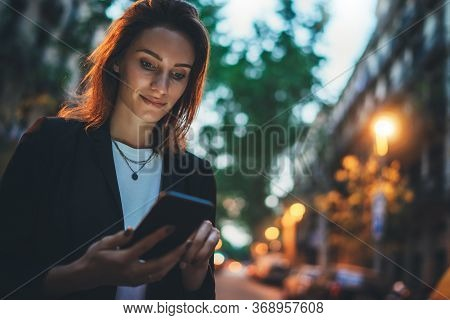 Elegant Woman Pointing On Screen Smartphone Background Lights In Night City Street, Tourist Girl Usi