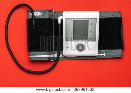 Medical Tool. Monitor Sphygmomanometer For Check Blood Pressure Isolated On Red Background. Medical