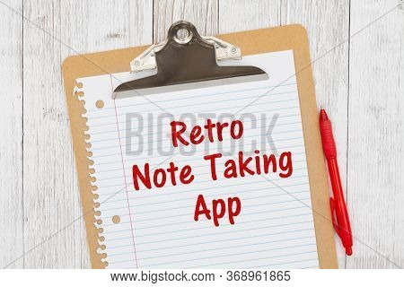 Retro Note Taking App Humorous Message On Lined Paper With A Pen On A Clipboard On Weathered Whitewa