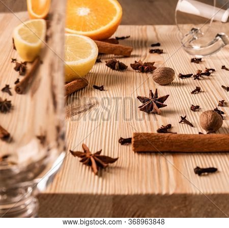 Differential Focus. Limpid Empty Glasses For Mulled Wine, Anise Flowers Stars, Nutmegs, Cloves, Frag