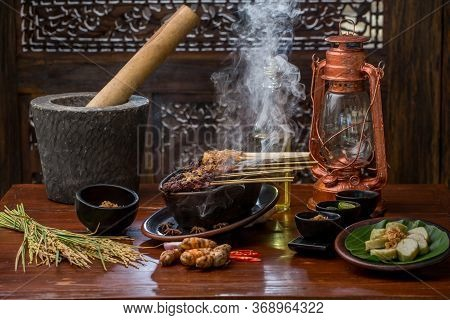 Satay Or Sate, Skewered Grilled Meat, Served With Peanut Sauce And Sauces. Malaysia Or Indonesia Foo