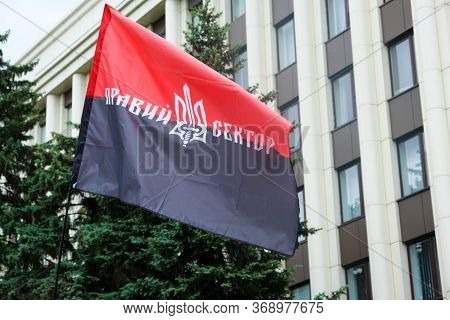 Red Black Patriotic Ukrainian Flag With The Inscription In Ukrainian - Right Sector And Coat Of Arms