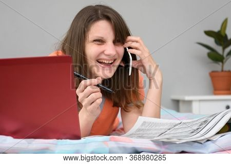 Girl Laughs A Lot While Talking With The Employer On The Phone And Looking For Work