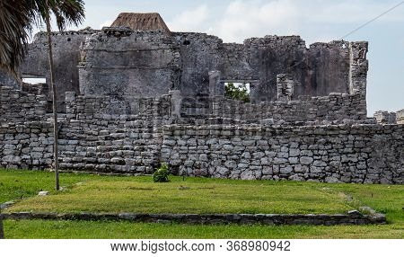 Side View Of Stone Walls And Ruins Situated In The Ancient Mayan City Of Tulum In Quintana Roo, Mexi