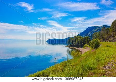 Awe View Of Baikal Lake On A Sunny Summer Day From The Shore O Near Circum-baikal Railway. Beautiful