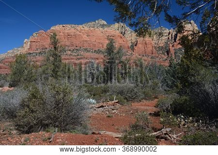 Sunny Vista On Red Rock Formations Visible From The Jim Thompson Trail Head In Rural Sedona, Norther