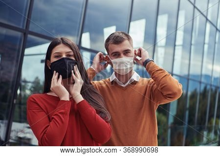 Business People team with protective medical safety Mask standing at Office Urban Building CoronaVirus in Business new normal outbreak Concept