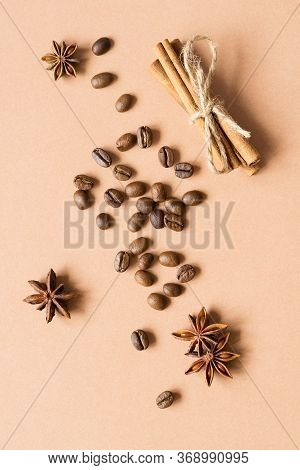 Coffee Beans And Cinnamon, Badyan On A Beige Background. Top View.