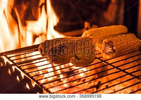 Ears Of Corn On A Grill Over High Heat, Night Shooting.
