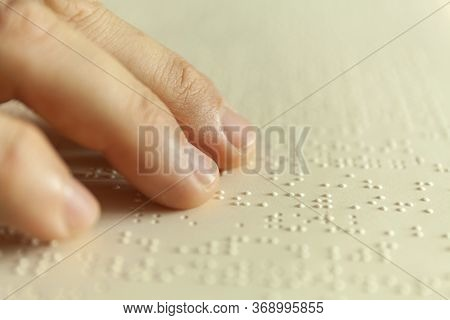 Braille Reading. Blind Man Reads A Book In Braille