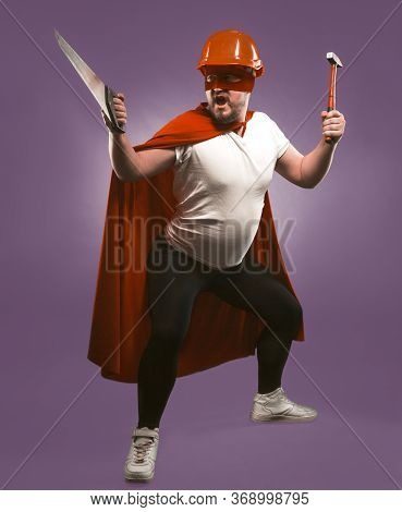 Super Hero Man Holding Construction Tools. Engineer Or Repairman In Red Helmet And Super Hero Unifor