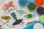 Beaded fishes and mermaid and colorful beads poster