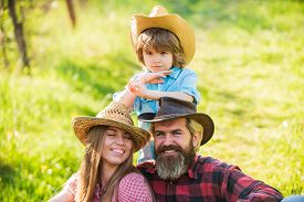 Lovely Family Nature Background. Farmers Relaxing. Reliable Support For Child. Family Values. Good R