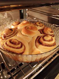 Cinnamon Bun Poppy Seeds Raisins Cream Glaze Bakery Product Tasty Dessert Food Photo