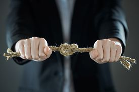 The Businessmans Hands Tighten The Rope Knot Against Background Of Suit In Blur.