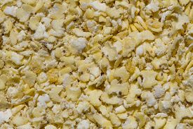 Close Up. Dry, Natural  Raw,  Yellow Millet Flakes Background. A Healthy Ingredient.