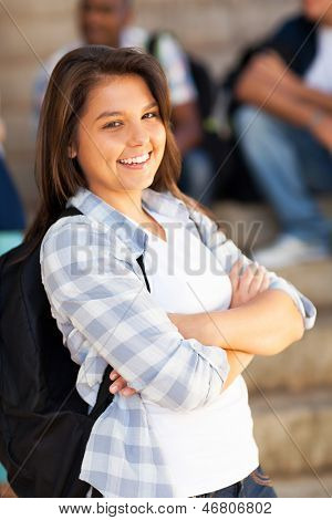 cute female highschool student with arms crossed