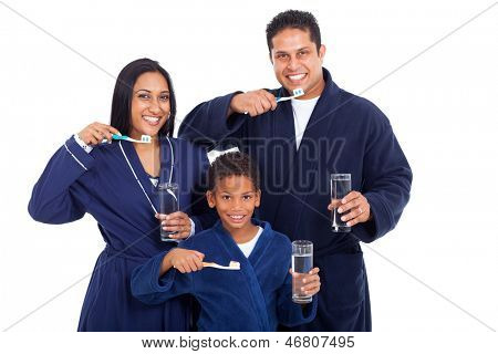 healthy young indian family brushing teeth together in pajamas