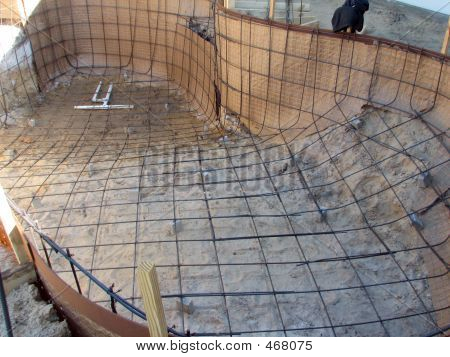 shot of a pool in construction, ready for the first layer of concrete. poster