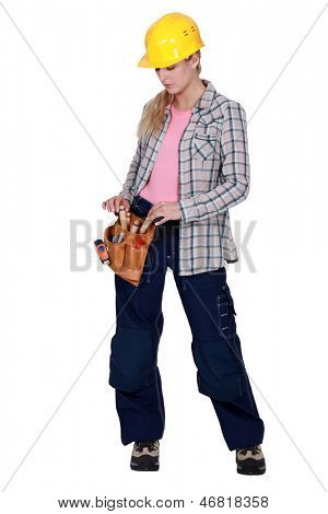 female apprentice with toolbelt