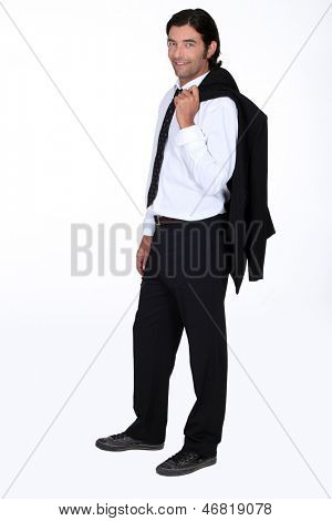 Handsome man with his suit jacket flung over his shoulder poster