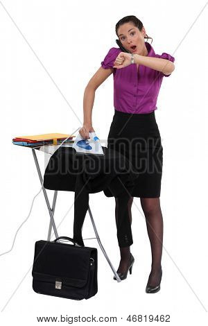 Woman doing her chores and running late.