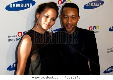 NEW YORK-MAY 29: Model Chrissy Teigen and singer John Legend attend the Samsung Hope for Children gala at Cipriani Wall Street on June 11, 2013 in New York City.