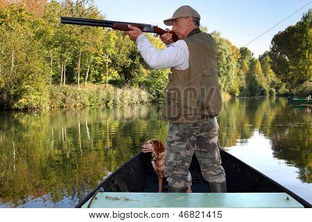 hunter in boat