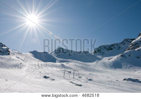 Ski Lift At High Altitude Resort, Sun With Flare