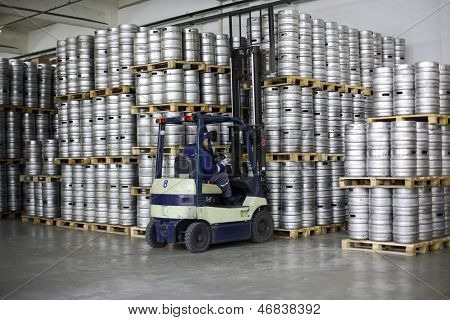 MOSCOW - OCT 16: Forklift loading beer kegs in stock brewery Ochakovo on October 16, 2012 in Moscow, Russia. Ochakovo is largest Russian company beer and soft drinks industry without foreign capital