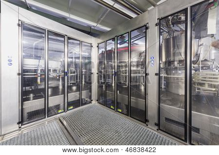 MOSCOW - OCT 16: Safety guards with doors in shop of brewery Ochakovo on October 16, 2012 in Moscow, Russia. Ochakovo is largest Russian company beer and soft drinks industry without foreign capital